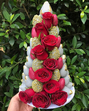 A striking strawberry tower perfect for a Christmas themed table