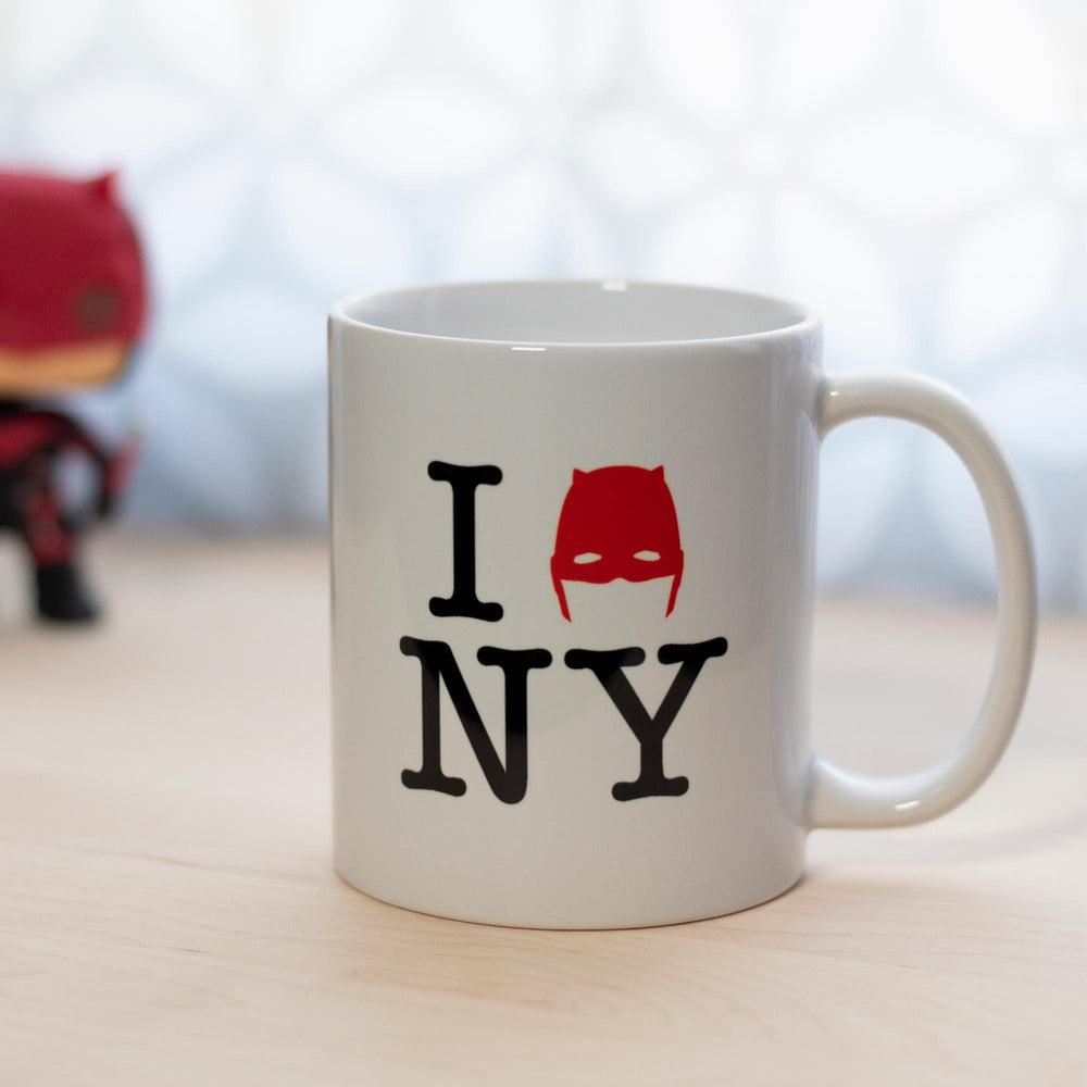 11oz Devil of Hell's Kitchen I Love New York Daredevil Mug with Daredevil Funko Pop in Background