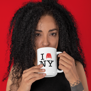 Woman drinking from 15oz Devil of Hell's Kitchen I Love New York Daredevil Mug