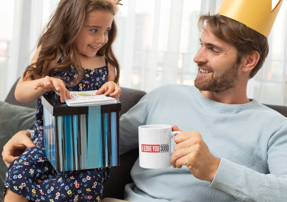 Dad holding I Love You 3000 mug with daughter on Father's Day