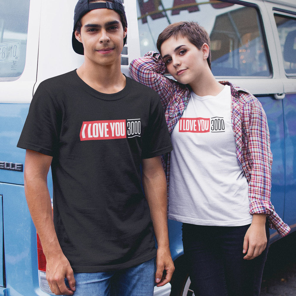 Couple wearing matching Black and White I Love You 3000 Short Sleeve T-Shirts in front of van