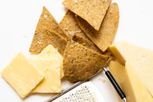 Load image into Gallery viewer, Primal Future's Cricket Corn Chips Aged Cheddar Flavour with blocks of aged cheddar and a silver cheese grater