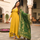 Yellow and green  Kurta & Pants of Cotton silk with machine embroidery and lace details on hem, Poly nylon gold jacquard dupatta.