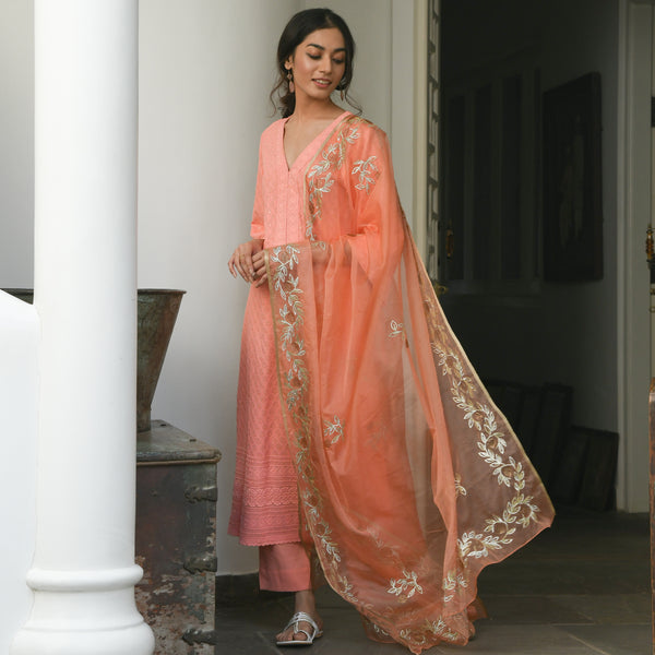 shop amazing quality peach chikankari suit with cotton pants and organza dupatta