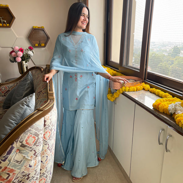 plume blue suit set with muslin kurta and sharara and chiffon dupatta