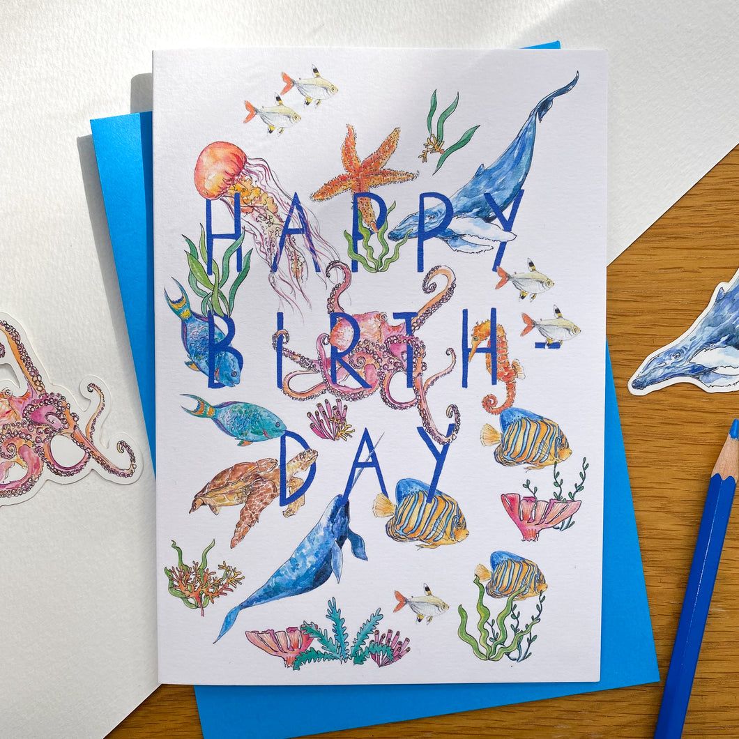Happy birthday card with sea creatures and blue envelope