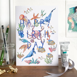 Happy birthday card with sea creatures standing on a mantlepiece