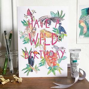 Have a Wild Birthday greetings card with animals on mantlepiece