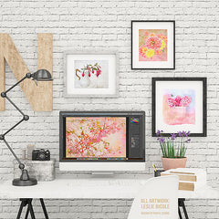 iMac styled scene with framed artwork.