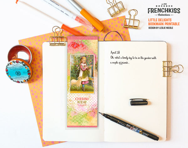 Little delights bookmark printable shown with a journal.