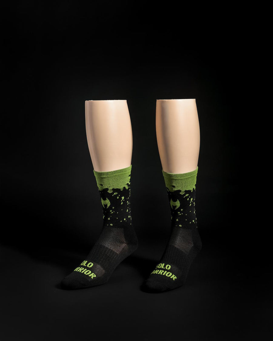 "The New ""Dripp"" black/green compression cycling sock adding sexy to dark side."