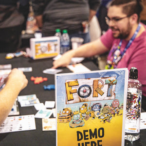 Leder Games employee demoing Fort at a convention