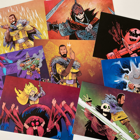 Array of art prints with illustrations from Vast the board game