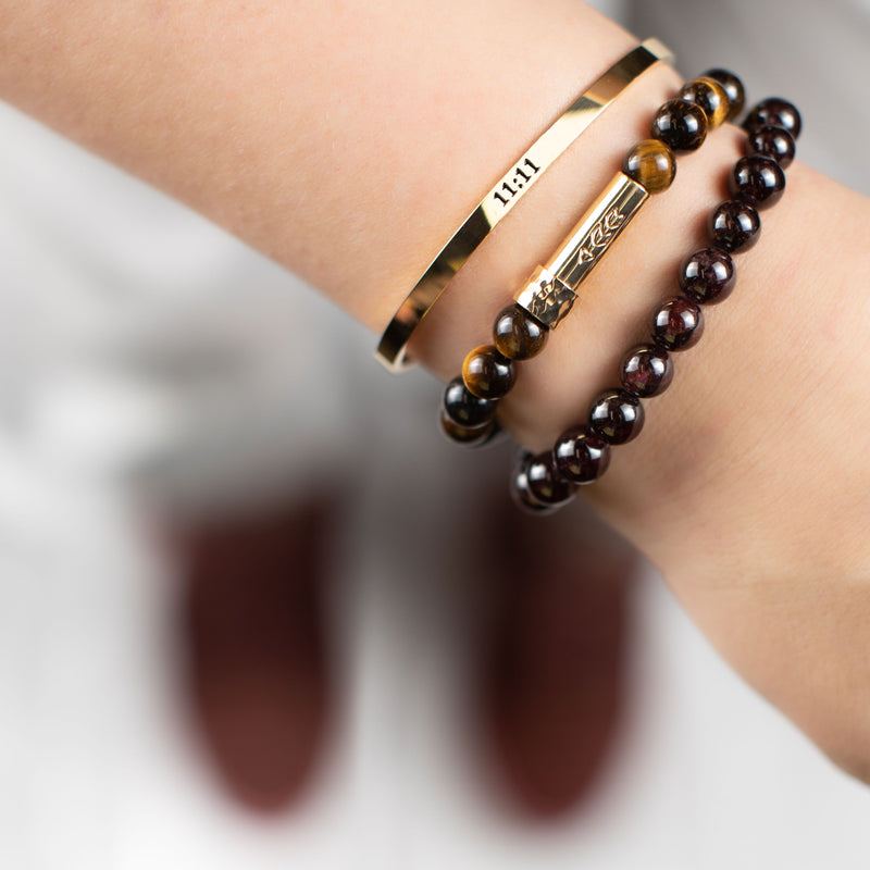 Gold inspiration cuff bracelet with 11:11 printed in black, with a Tigers Eye Gemstone beaded Wish Bracelet with a gold cylinder clasp that unscrews to allow a written message to go inside bracelet.