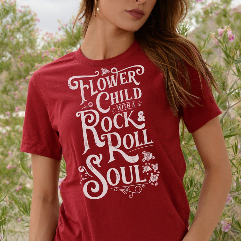Woman wearing T-shirt with distressed white Flower Child With A Rock and Roll Soul graphic