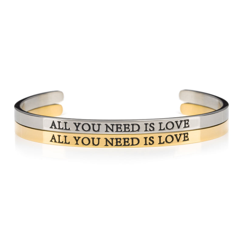 1 silver and 1 gold open cuff bracelet that say ALL YOU NEED IS LOVE