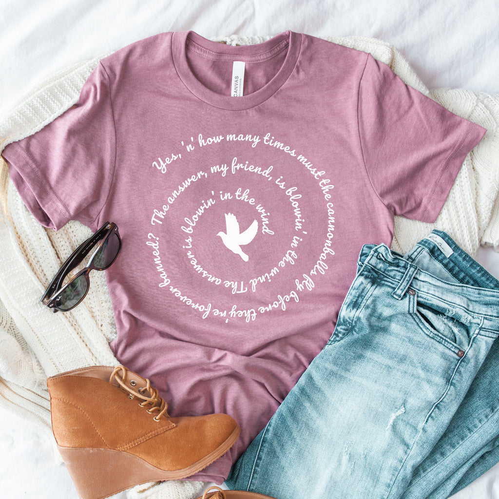 Womens tee shirt with bob dylan lyrics blowin' in the wind spiral graphic pairedwith jeans and suede boots