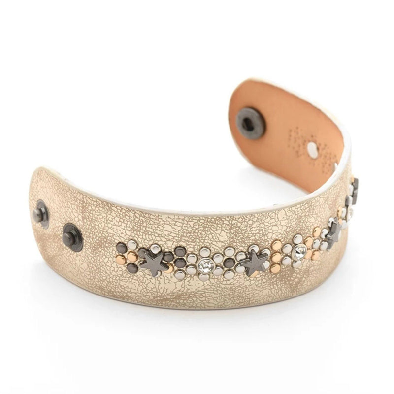 Gold leather cuff bracelet with gold and silver circular studs and metal star accents