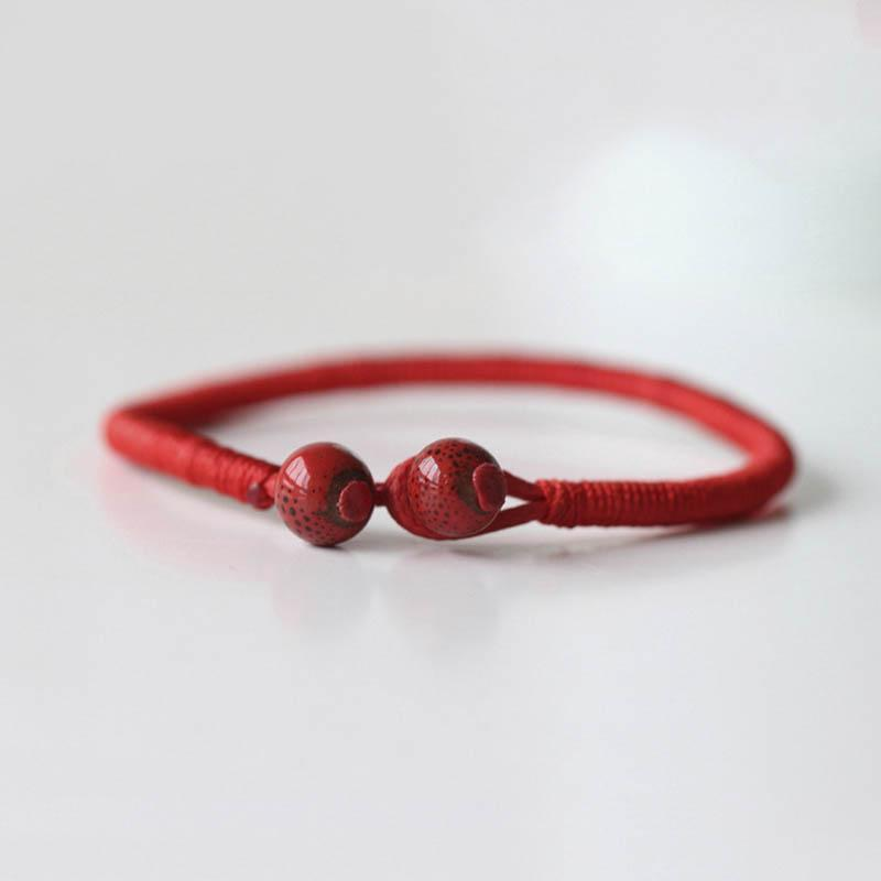 Hatha Red String Bracelet with 2 red ceramic beads for luck and protection