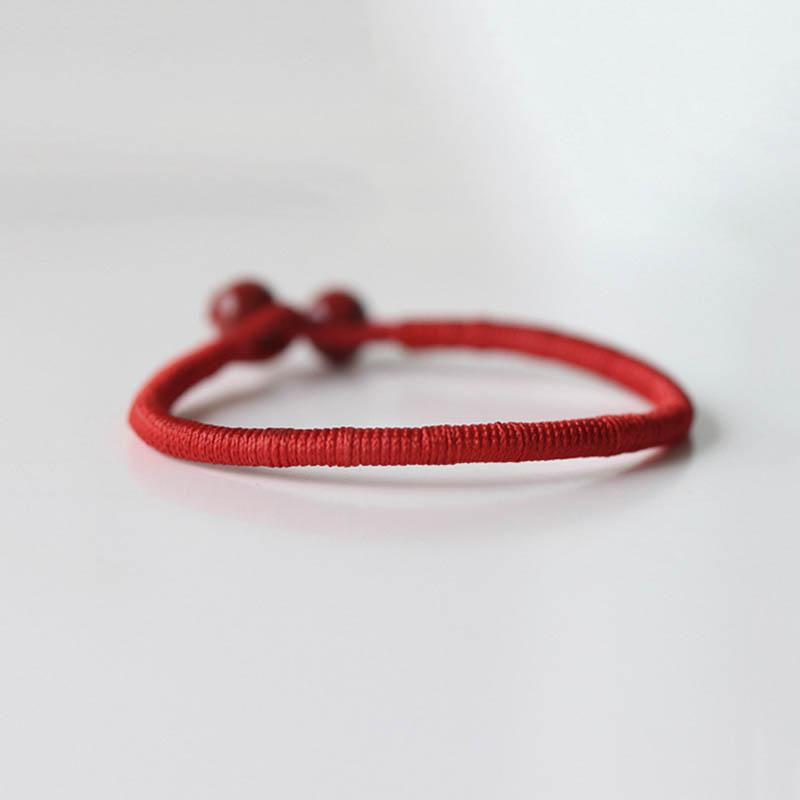 Hatha Lucky Red String Protection Bracelet with 2 red ceramic beads
