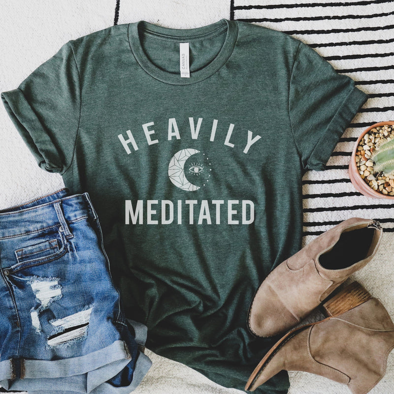 Womens heather forest green t-shirt with white HEAVILY MEDITATED graphic and a white moon in the center