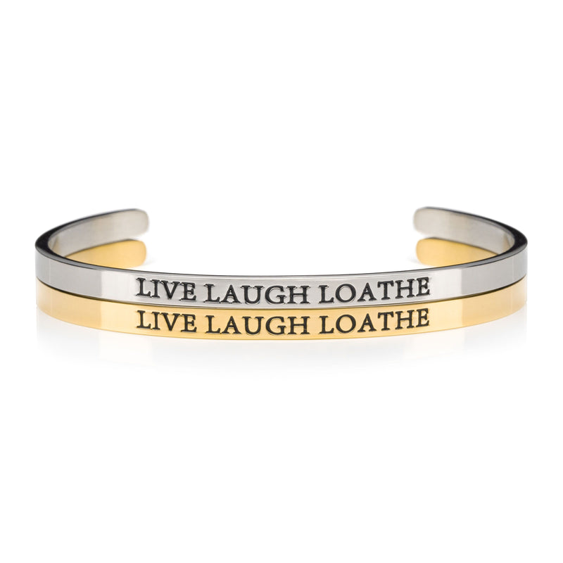 1 silver and 1 gold open cuff bracelet that say LIVE LAUGH LOATH