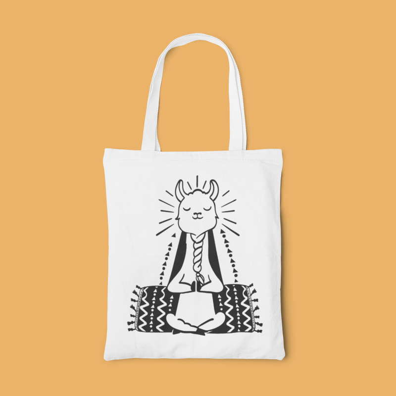 White canvas tote bag with black graphic of a meditating llama with twisted beard sitting cross-legged doing yoga