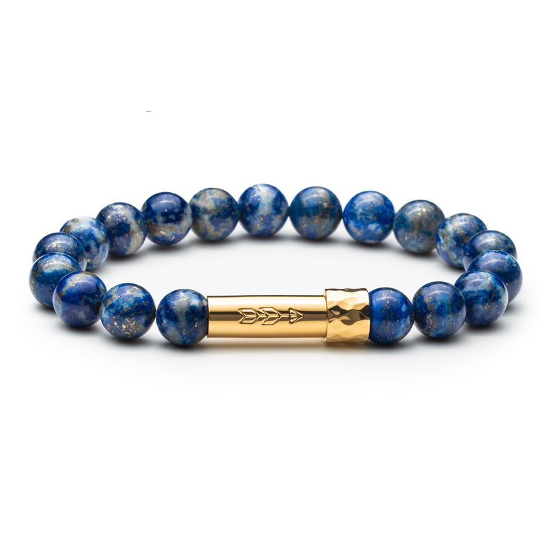Blue lapis lazuli gemstone beaded intention bracelet with gold tube clasp with handstamped arrow. Clasp unscrews to allow for a small paper scroll to be inserted with a mantra.