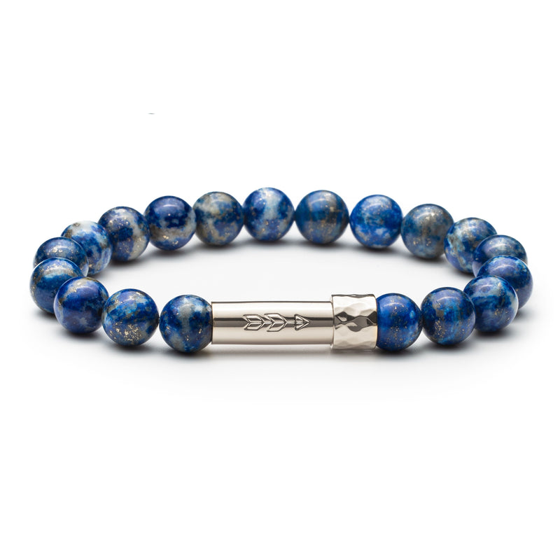 Blue lapis lazuli gemstone beaded intention bracelet with silver tube clasp with handstamped arrow. Clasp unscrews to allow for a small paper scroll to be inserted with a mantra.