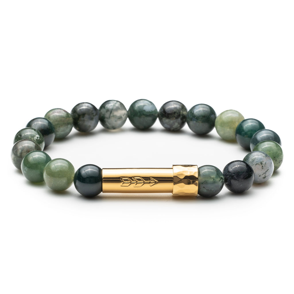 Green moss agate gemstone beaded intention bracelet with gold cylinder clasp that unscrews to hold a scroll of paper. Clasp features a handstamped arrow.