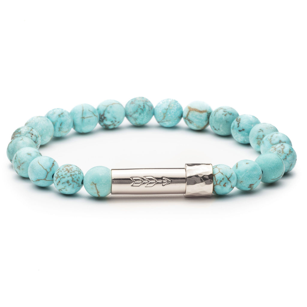 Matte Turquoise gemstone beaded intention bracelet with silver tube clasp with handstamped arrow. Clasp unscrews to allow for a small paper scroll to be inserted with a mantra.