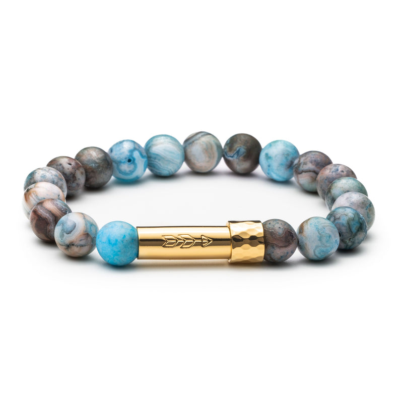 Blue and brown marble-colored gemstone beaded intention bracelet with gold  tube clasp with handstamped arrow. Clasp unscrews to allow for a small paper scroll to be inserted into clasp with a mantra.