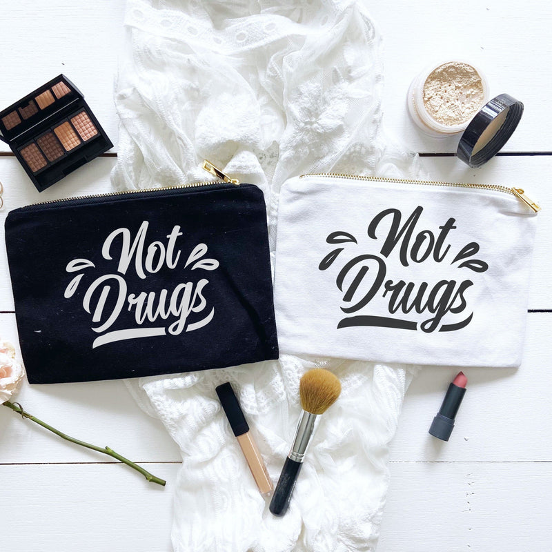 Not drugs black canvas make-up bag and not drugs white canvas make-up bag 2 gold zippered cosmetic bags