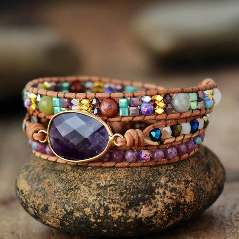 3 layer leather and gemstone boho wrap bracelet with large Amethyst centerpiece and Lepidolite accents - bracelet sitting on a rock
