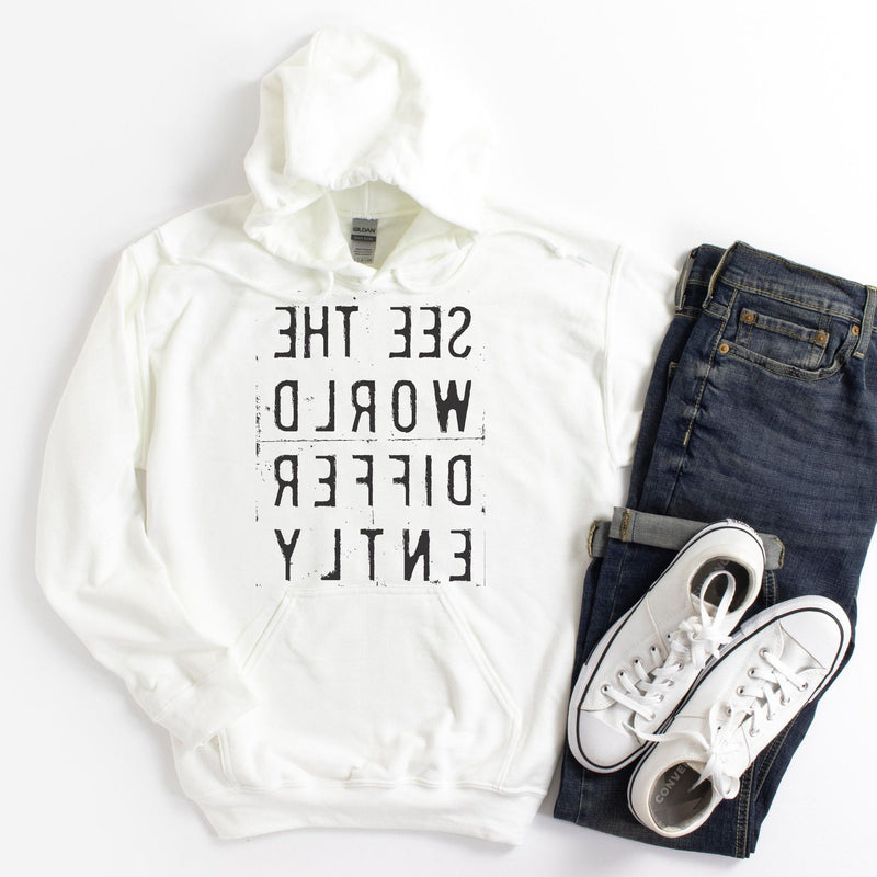 White hoodie sweatshirt with reverse black letters that say See The World Differently backwards