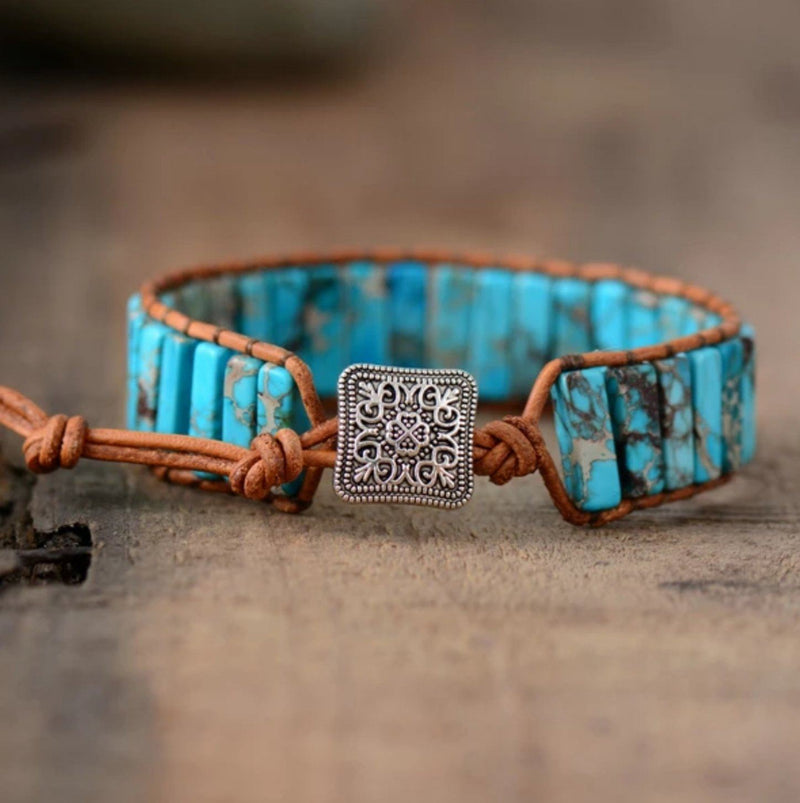 Turquoise stone and brown leather beaded chakra bracelet with silver button closure
