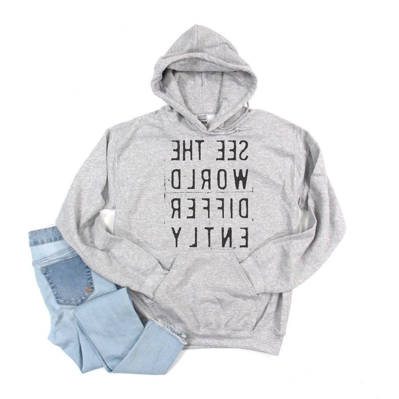 Heather Gray hoodie sweatshirt with reverse black letters that say See The World Differently backwards