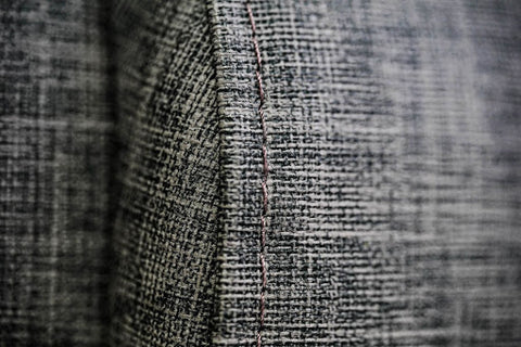 Grey sofa fabric and stitching details