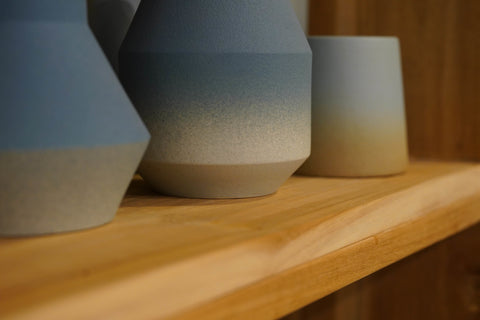 Blue Gradient Pottery Display on Wooden Bookshelves at Gallery 278 by Esco Leasing