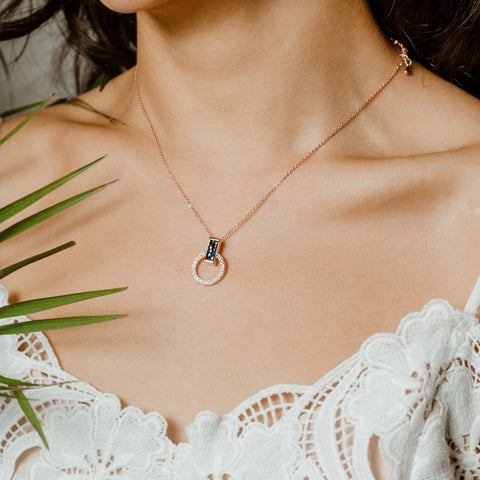 A model wearing a necklace from Forest Jewelry