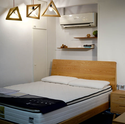 Namu Furniture's Beaumont Bed Frame, paired with a bedside table and light accessories