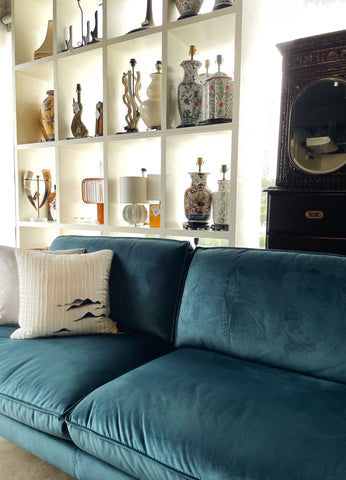Featuring WTP Furniture's showroom with a green suade sofa with 2 throw pillows on top of it