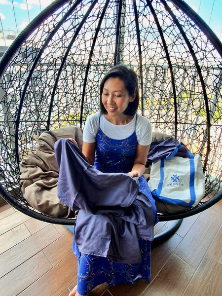 Sharon Ismail with Weavve Home Lyocell Tencel Bed Sheets in Dark Blue.