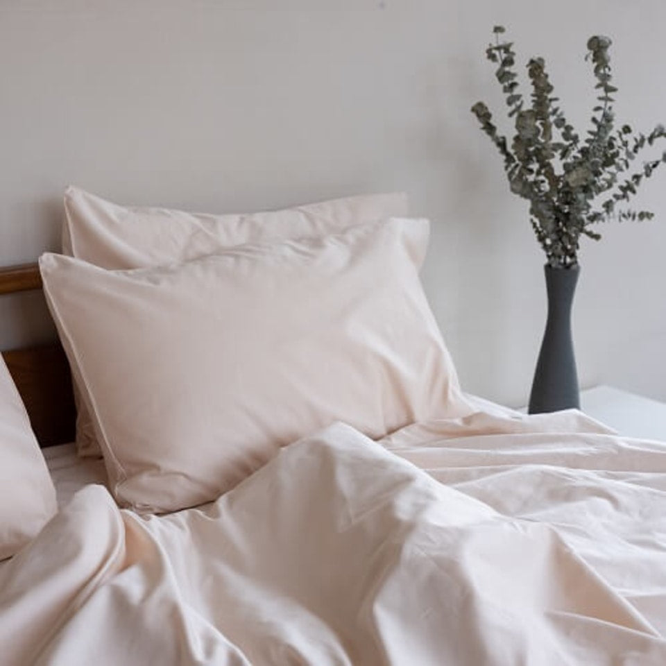 light beige bed sheets with two pillows