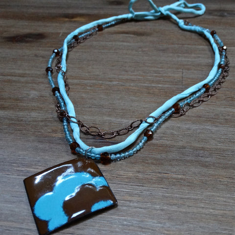 3 Strand Aqua and Brown Necklace with Enamel Flower Pendant