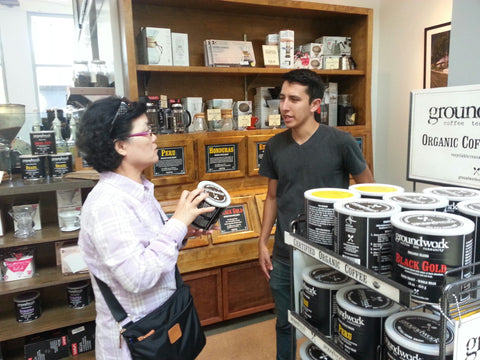 Barista talks coffee selection with Groundwork costumer.
