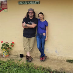 Groundwork Coffee Jeff Chean poses with Angela Pelaez of RGC Coffee outside of a building in Colombia
