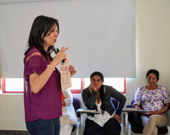 women teaches a gender training program in colombia