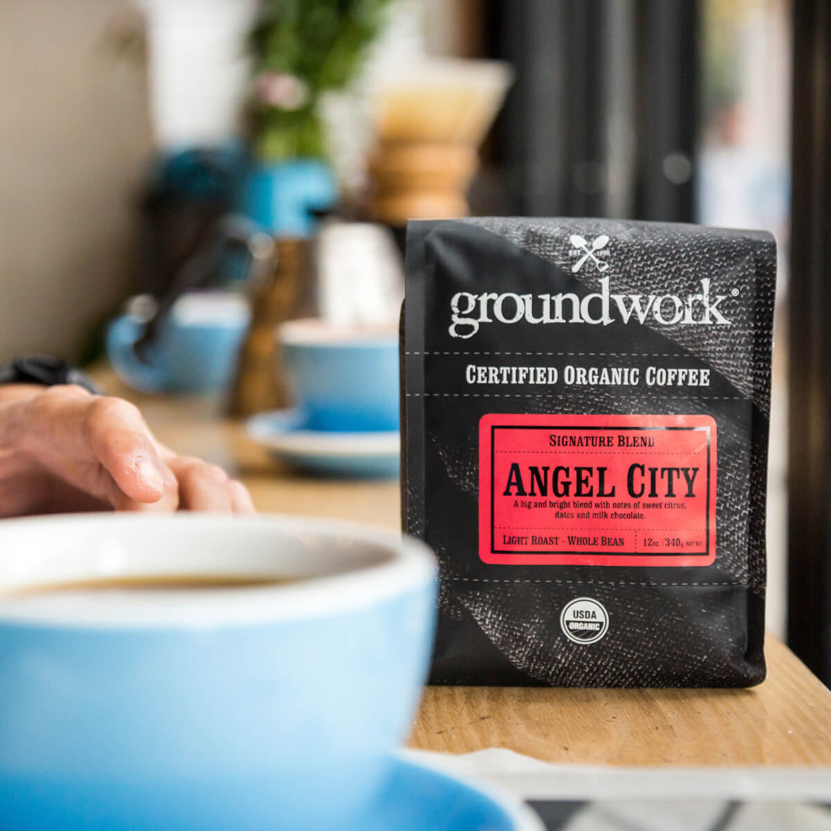 bag of Groundwork's Angel City coffee on table with blue cup