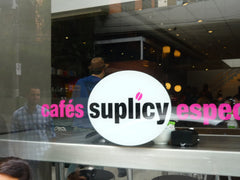 Suplicy cafe sign in window.